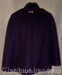 Cloak:3022, Cloak Style:Collared short shape shoulder<br>cloak youth with liripipe, Cloak Color:Deep Purple, Fiber / Weave:100% Wool, Cloak Clasp:Alpine Knot - Silvertone, Hood Lining:N/A, Back Length:28&quot;, Neck Length:19&quot;, Seasons:Fall, Spring, Note:With a shaped shoulder for a<br>more tailored look this<br>collared purple cloak is a<br>perfect starter cloak for a youth.<br>Adorned with a silver tone<br>stina hook and eye clasp<br>good for cool evenings<br>for a fun addition to any wardrobe.<br>Dry clean only.