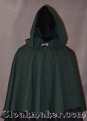 Cloak:3023, Cloak Style:Short Shape Shoulder Cloak<br> youth with liripipe, Cloak Color:Green, Fiber / Weave:100% Lt Weight Gabardine Wool, Cloak Clasp:Stina Pewter, Hood Lining:Unlined, Back Length:25.5&quot;, Neck Length:19.5&quot;, Seasons:Summer, Fall, Spring, Note:Made of a light weight gabardine<br>wool this green short shaped<br>shoulder cloak is perfect<br>for a youth starter cloak<br>will fit longer than a<br>coat as they grow.<br>Features a lirepipe hood,<br>great for use as a scarf or storage,<br>adorned with a silver<br>alpine knot hook-and-eye clasp.<br>Dry clean only.