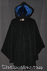 Cloak:3027, Cloak Style:Cape / Ruana extra long<br>over the shoulder, Cloak Color:Grey, Fiber / Weave:Plush 100% Wool Melton<br>with herringbone Pattern, Cloak Clasp:Geranium Leaves<br>Medium Silvertone, Hood Lining:Blue Cotton Velvet, Back Length:41&quot; back<br>29&quot; overarm, Neck Length:20&quot;, Seasons:Winter, Southern Winter, Fall, Spring, Note:A cross between a cape and a cloak,<br>a ruana is a great way to keep warm<br>while frequent, unhindered use of<br>your arms is needed.<br>Ruanas make great driving cloaks!<br>This gorgeous plush wool melton<br>with herringbone pattern with a<br>lovely Scottish Irish look.<br>Accented by a blue cotton<br>velvet lining and silver tone<br>geranium hook and eye clasp.<br>Dry Clean Only.