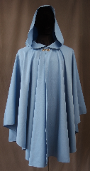 Cloak:3034, Cloak Style:Ruana, Cloak Color:Light Blue, Fiber / Weave:80% Wool / 20% Gabardine, Cloak Clasp:Stina Pewter, Hood Lining:Unlined, Back Length:36&quot;, Neck Length:19.5&quot;, Seasons:Fall, Spring, Note:A cross between a cape and a cloak,<br>a ruana is a great way to keep warm<br>while frequent, unhindered use<br>of your arms is needed.<br>This light blue wool gabardine ruana<br>is lightweight and has a dramatic<br>swoosh/drape perfect for<br>indoor and outdoor events<br> Accented with a silver tone stina<br>hook-and-eye clasp.<br>Sized for petite adults,<br>Dry Clean only..