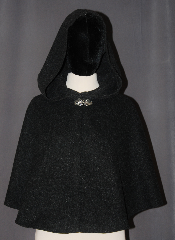 Cloak:3035, Cloak Style:Full Circle Short Cloak, Cloak Color:Charcoal Grey, Fiber / Weave:80% Wool / 20% Nylon, Cloak Clasp:Vale, Hood Lining:Unlined, Back Length:21.5&quot;, Neck Length:20.5&quot;, Seasons:Fall, Spring, Southern Winter, Note:Perfect starter cloak for a child<br>or a fashionable adult<br>alternative to a shawl.<br>This dark grey short cloak<br>s made of a heathered<br>wool blend and feels like felt.<br>The silver tone Vale<br>hook and eye clasp completes<br>the look for cool evenings.<br>A fun addition to any wardrobe.<br>Dry Clean Only..
