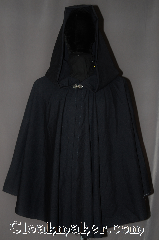 Cloak:3040, Cloak Style:Ruana, Cloak Color:Navy Blue, Fiber / Weave:100% Wool, Cloak Clasp:Stina Pewter, Hood Lining:Unlined, Back Length:30&quot;<br>28&quot; overarm, Neck Length:21&quot;, Seasons:Summer, Fall, Spring, Note:A cross between a cape and a cloak,<br>a ruana is a great way to keep warm<br>while frequent, unhindered use<br>of your arms is needed.<br>This navy blue wool ruana<br>is tropical weight and<br>has a dramatic<br>swoosh/drape perfect for<br>indoor and outdoor events<br> Accented with a silver tone stina<br>hook-and-eye clasp.<br>Dry Clean only..