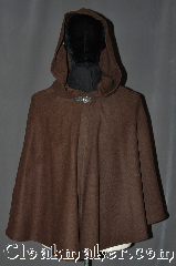 Cloak:3045, Cloak Style:Shaped Shoulder Cloak - Short, Cloak Color:Olive Brown, Fiber / Weave:80% Wool / 20% Nylon, Cloak Clasp:Vale, Hood Lining:Unlined, Back Length:29.5&quot;, Neck Length:21&quot;, Seasons:Fall, Spring, Southern Winter, Note:This olive brown short<br>shape shoulder cloak<br>is a great starter cloak<br>or a fashionable<br>alternative to a shawl.<br>Made of a wool blend<br> this cloak is unlined.<br>Accented with a<br>silver tone vale<br>hook-and-eye clasp.<br>Dry Clean only..