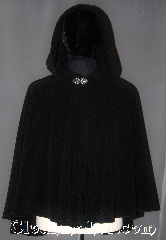 Cloak:3050, Cloak Style:Shaped Shoulder Cloak - Short, Cloak Color:Black, Fiber / Weave:Windblock Polar Fleece, Cloak Clasp:Vale, Hood Lining:Unlined, Back Length:30&quot;, Neck Length:21&quot;, Seasons:Winter, Southern Winter, Fall, Spring, Note:Perfect starter cloak for a child<br>or adult on cold winter<br>evenings with a weighted<br>protection from winter winds.<br>Extra caution recommended<br>when crossing streets,<br>air will be blocked and<br>sounds will be muffled.<br>Partially water resistant.<br>Adorned with a silver tone<br>vale hook-and-eye clasp.<br>Machine Washable.<br>Never dry clean.