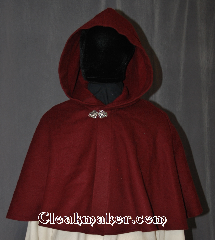 Cloak:3062, Cloak Style:Shaped Shoulder Cloak - Short, Cloak Color:Maroon, Fiber / Weave:100% Wool, Cloak Clasp:Vale, Hood Lining:Unlined, Back Length:18&quot;, Neck Length:22&quot;, Seasons:Fall, Spring, Note:This short shape shoulder cloak<br>is perfect for adding just a touch<br>of drama and elegance.<br>Made from a maroon 100% wool<br>this cloak is unlined, and finished off<br>with a classic Vale hook-and-eye clasp.<br>Dry Clean only.