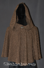 Cloak:3078, Cloak Style:Ruana short lirapipe, Cloak Color:Tan and black weave, Fiber / Weave:Tropical Weight Wool Poly Blend, Cloak Clasp:Vale, Hood Lining:Unlined, with 37&quot; lirapipe, Back Length:26&quot;, Neck Length:20&quot;, Seasons:Fall, Spring, Note:A one of a kind short ruana cloak<br>with a lirapipe hood.<br>Perfect for a dramatic<br>entrance and practical.<br>You can use your hood as<br>a scarf or pocket.<br>Made from a woven wool poly<br>of tan and black and adorned with a<br>hook and eye vale clasp.<br>Hand wash tropical weight.