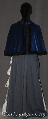 Cloak:3079, Cloak Style:Shape shoulder short hoodless Victorian Cape, Cloak Color:Royal Blue / Black trim, Fiber / Weave:Cotton Velveteen, Cloak Clasp:Snap Button, Hood Lining:N/A, Back Length:21.5&quot;, Neck Length:20.5&quot;, Seasons:Fall, Spring, Southern Winter, Note:A hood-less true Victorian<br>short cape with black trim<br>Perfect for any age.<br>Designed for a elegant<br>night out on the town.<br>Accented with a mandarin<br>collar and snap clasp.<br>Hand washable..
