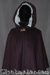 Cloak:3096, Cloak Style:Shaped Shoulder<br>Short Cloak, Cloak Color:Purple, Fiber / Weave:Wool, Cloak Clasp:Vale, Hood Lining:Light Blue Moleskin, Back Length:24&quot;, Neck Length:21&quot;, Seasons:Fall, Spring, Southern Winter, Note:A wonderful starter cloak for a<br> child or adult.<br>Bright and colorful sized for<br>play and walking.<br>With shaped shoulders for<br>a more secure fit.<br>Dry clean only..