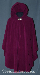 Cloak:3101, Cloak Style:Shaped Shoulder Ruana Cloak, Cloak Color:Fuschia / Dark Orchid, Fiber / Weave:Windpro Fleece, Cloak Clasp:Triple Medallion, Hood Lining:Self-lining, Back Length:39&quot;, Neck Length:21&quot;, Seasons:Winter, Fall, Spring, Note:Warm and cozy this lightweight<br>shaped shoulder ruana<br>windpro fleece cloak is<br>perfect for cold evenings.<br>A cross between a cape and a cloak,<br>a ruana is a great way to keep warm<br>while frequent, unhindered use of<br>your arms is needed.<br>With an overarm of 31&quot; this cloak<br>has less bulk than a<br>traditional Ruana and<br>makes a great driving cloak!<br>Machine washable..