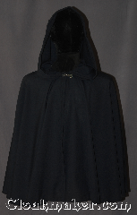 Cloak:3110, Cloak Style:Short Shape Shoulder Cloak<br>With Pointed Hood, Cloak Color:Navy Blue almost Black, Fiber / Weave:Wool Blend Suiting, Cloak Clasp:Stina Pewter, Hood Lining:Unlined pointed, Back Length:26.5&quot;, Neck Length:19.5&quot;, Seasons:Fall, Spring, Note:Lightweight and easy care,<br>in a nearly black navy,<br>this short cloak is a great piece<br>of spring outerwear.<br>Made with a breathable wool blend<br>suiting this unlined cloak  makes a<br>great accessory for everyday wear,<br> LARP or Renaissance Fair.<br>Features a pointed hood<br>The cloak is machine washable, so throw it on<br>whenever you need some extra warmth.<br>A perfect starter cloak for a child or adult.