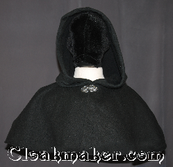 Cloak:3122, Cloak Style:Shaped Shoulder-Short, Cloak Color:Black, Fiber / Weave:Windpro herringbone Polar Fleece, Cloak Clasp:Vale, Hood Lining:Unlined, Back Length:11&quot;, Neck Length:19&quot;, Seasons:Fall, Spring, Southern Winter, Note:A wonderful starter cloak for a<br>child or adult.<br>This black windpro polar fleece<br>with a felted interior<br>is warm enough for most winters<br>Sized for play and walking.<br>Water resistant<br>  Machine washable..