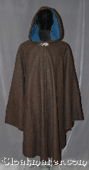 Cloak:3131, Cloak Style:Shaped Shoulder Ruana Cloak, Cloak Color:Heathered Brown, Fiber / Weave:100% Wool  Melton, Cloak Clasp:Triple Medallion, Hood Lining:Indigo blue cotton velvet, Back Length:46&quot;<br>overarm 36&quot;, Neck Length:22.5&quot;, Seasons:Fall, Spring, Southern Winter, Winter, Note:This gorgeous warm heathered brown<br>shape shoulder ruana cloak with an<br>indigo blue velvet hood is<br>perfect for a night on the town.<br>Made of a wool blend melton<br>with flecks of color throughout,<br>it is mesmerizing.<br>A cross between a cape and a cloak,<br>a ruana is a great way to keep warm<br>while frequent, unhindered use of<br>your arms is needed.<br>With an overarm of 36&quot; this cloak<br>has less bulk than a<br>traditional Ruana and<br>makes a great driving cloak!<br>Can be hemmed to height<br> Dry Clean Only.