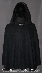 Cloak:3157, Cloak Style:Shaped Shoulder Ruana Cloak, Cloak Color:Navy Blue almost Black<br>peacock and royal blue heather<br>(slightly scratchy), Fiber / Weave:Wool Blend, Cloak Clasp:Vale, Hood Lining:unlined with black ribbon trim, Back Length:24.5&quot;, Neck Length:23&quot;, Seasons:Fall, Spring, Note:The pictures do not do this<br>shape shoulder cloak justice.<br>Made from a gorgeous,<br>slightly scratchy, navy blue<br> wool blend heathered with<br>jewel tone blues and greens <br>The front interior is trimmed with<br>black ribbon and adorned with<br>a classic vale hook-and-eye clasp.<br>Dry Clean Only..