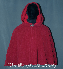Cloak:3172, Cloak Style:Shaped Shoulder Cloak - Short, Cloak Color:Raspberry Red / Cherry Red, Fiber / Weave:Windblock Polar Fleece, Cloak Clasp:Triple Medallion, Hood Lining:N/A<br>Two tone fabric with<br>red interior raspberry exterior, Back Length:25&quot;, Neck Length:19&quot;, Seasons:Winter, Southern Winter, Fall, Spring, Note:A one of a kind shape shoulder cloak<br>made from the warmest fabric you<br>can find. Designed to block cold<br>winter winds and resist water.<br>This fleece is two tone discontinued<br>color combination of raspberry<br>on the outside and cherry on the inside<br>for that added pop of color.<br>Machine washable NEVER DRY CLEAN..