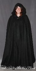 Cloak:3290, Cloak Style:Full Circle Cloak, Cloak Color:Black, Fiber / Weave:Fleece, Cloak Clasp:Vale, Hood Lining:Unlined, Back Length:60&quot;, Neck Length:20&quot;, Seasons:Fall, Spring, Note:Lightweight black economy fleece<br>provides a warmth with<br>very little weight.&nbsp;Suitable for<br>indoor wear late spring, early fall,<br>cool summer evenings or just<br>snuggling on the couch.<br>Machine washable. <br>Vale clasp perfect for<br>football spectators and players..