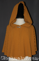 Cloak:3196, Cloak Style:pullover Capelet, Cloak Color:Tumeric yellow, Fiber / Weave:Polyester Rayon, Cloak Clasp:Stina Pewter, Hood Lining:Unlined, Back Length:20.75&quot;, Neck Length:23.5&quot;, Seasons:Summer, Spring, Fall, Note:Lightweight and cool to the touch<br>this undulant short pullover capelet<br>is a wonderful starter cloak<br>for young adults or an elegant shrug<br>for a night on the town.<br>With a keyhole neck and<br>Stina Pewter closure you can<br>throw it on and go anywhere with style.<br>Machine washable..