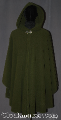 Cloak:3200, Cloak Style:Shaped Shoulder Ruana Cloak, Cloak Color:Olive Green, Fiber / Weave:WindPro Fleece, Cloak Clasp:Triple Medallion, Hood Lining:Unlined faux shearling<br>interior double sided fabric, Back Length:43&quot; back<br>28&quot; overarm, Neck Length:22&quot;, Seasons:Fall, Spring, Winter, Note:A classic olive green windpro<br>shape shoulder ruana<br>that will keep you warm<br>and dry on chilly nights.<br>This soft and cuddly cloak<br>has a faux shearling interior<br>texture for extra comfort<br>and a water resistant<br>outer layer to keep you dry<br>during light rain/snow.<br>The silvertone triple medallion<br>clasp is the final touch on this<br>functional and elegant cloak.<br>This shape shoulder ruana<br>makes a great driving cloak<br>with shorter sides and less<br>bulk easy arm mobility . <br>Machine washable<br>DO NOT DRY CLEAN..