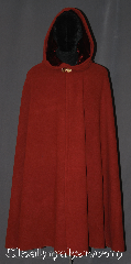 Cloak:3211, Cloak Style:Shaped Shoulder Cloak with arm slits, Cloak Color:Sienna rust red, Fiber / Weave:100% Wool coating, Cloak Clasp:Vale - Goldtone, Hood Lining:Garnet red Velvet, Back Length:44&quot;, Neck Length:21&quot;, Seasons:Southern Winter, Fall, Spring, Note:Gorgeous and earthy,<br>this sienna rust<br>shape shoulder cloak<br>with side arm slits<br>is designed with less bulk<br>of a full circle and easy arm<br>access with arm slits<br>this is a versatile cloak for<br>everyday activities and driving.<br>With accents of a garnet lined<br>hood and a goldtone vale clasp<br> this cloak is perfect for fall fashion.<br>Dry or spot clean only..