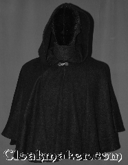 Cloak:3220, Cloak Style:Short pullover cloak, Cloak Color:Black, Fiber / Weave:Economy Fleece, Hood Lining:Unlined keyhole neck, Back Length:23&quot; back<br>22&quot; sides, Neck Length:22&quot;, Seasons:Fall, Spring, Note:A light weight economy fleece<br>black shape shoulder pullover cloak<br>you would love to snuggle.<br>A perfect starter cloak for a<br>young adult with a keyhole neck.<br>  Designed with less bulk<br>for easy arm mobility.<br>Spot dry clean only..