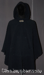 Cloak:3225, Cloak Style:Shaped Shoulder Ruana Cloak<br>with pockets, Cloak Color:Navy Blue, Fiber / Weave:WindPro Fleece, Cloak Clasp:Triple Medallion, Hood Lining:Unlined faux shearling interior<br>double sided fabric, Back Length:39&quot; back<br>29&quot; overarm, Neck Length:21&quot;, Seasons:Fall, Spring, Winter, Note:A classic navy blue windpro<br>shape shoulder ruana WITH POCKETS!<br>that will keep you warm and dry on chilly nights.<br>This soft and cuddly cloak has an<br>interior faux shearling texture<br>for extra comfort and a water resistant<br>outer layer to keep you dry during light rain/snow.<br>The pewter triple medallion clasp is the<br>final touch on this functional and elegant cloak.<br>This shape shoulder ruana makes a<br>great driving cloak with shorter sides and<br>less bulk easy arm mobility.<br>Machine washable<br>DO NOT DRY CLEAN..