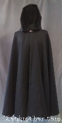 Cloak:3228, Cloak Style:Full Circle Cloak, Cloak Color:Black, Fiber / Weave:100% Wool Twill, Brushed, Cloak Clasp:Vale, Hood Lining:Crinkle black velvet, Back Length:46&quot;, Neck Length:19.5&quot;, Seasons:Southern Winter, Fall, Spring, Winter, Note:Elegant in black, this mid-weight<br>black full-circle cloak has a<br>lined crinkle velvet hood<br>with a soft wool twill body.<br>Warm enough for a southern<br>winter chill but roomy enough for<br>extra layers for when father<br>winter packs a punch.<br>Adorned with a silvertone<br>Vale hook and eye clasp.<br>Dry clean only.