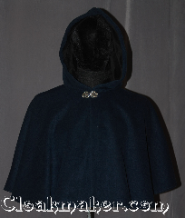 Cloak:3234, Cloak Style:Shaped Shoulder-Short (youth), Cloak Color:Heathered Navy and Sapphire Blue, Fiber / Weave:Fall, Spring, Southern Winter, Cloak Clasp:Vale, Hood Lining:Black Cotton Velveteen, Back Length:21&quot;, Neck Length:19&quot;, Seasons:Fall, Spring, Southern Winter, Note:This Heathered Navy and Sapphire Blue<br>wool blend youth shape shoulder<br>cloak is a great conversation piece<br>with woven texture throughout<br>resulting in subtle variations in<br>color with different lighting<br> The hood is lined in a durable<br>black velveteen for added warmth and<br>slip prevention from light winds.<br>Spot or dry clean only..