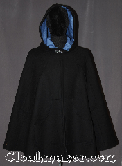 Cloak:3239, Cloak Style:Shaped Shoulder Cloak<br>Midlength with arm-slits and pockets, Cloak Color:Black, Fiber / Weave:100% Wool, Cloak Clasp:Vale, Hood Lining:Cornflower Blue Moleskin, Back Length:37&quot;, Neck Length:20&quot;, Seasons:Fall, Spring, Note:This soft black shape shoulder cloak is<br>fashionable and functional with both<br>arm-slits and pockets for ease of<br>arm movement and warm hands.<br>Ideal for brisk days when you still<br>have to get things done.<br>Accented with a cornflower blue lined<br>hood and silvertone vale clasp.<br>Spot or dry clean only..