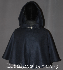 Cloak:3250, Cloak Style:Capelet, Cloak Color:Navy Blue, Fiber / Weave:Wool Twill Suiting, Cloak Clasp:Stina Pewter, Hood Lining:Unlined, Back Length:19&quot;, Neck Length:18&quot;, Seasons:Fall, Spring, Note:A perfect short capelet for a starter cloak<br>or formal evening during cold receptions.<br>Made of a navy wool blend twill suiting<br>and adorned with an<br>elegant stina pewter clasp.<br>Dry or spot clean only..