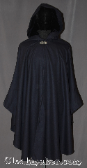 Cloak:3265, Cloak Style:Ruana Shaped Shoulder Cloak, Cloak Color:Navy Blue, Fiber / Weave:100% Wool Twill, Cloak Clasp:Vale, Hood Lining:Navy Polyester Velour, Back Length:44&quot; back<br>29&quot; sides, Neck Length:21&quot;, Seasons:Fall, Spring, Note:A classic navy blue full circle cloak<br>with a matching navy thick pile<br>velour lined hood.<br>Perfect for fall outings.<br>A cross between a cape and a cloak,<br>a shape shoulder ruana is a<br>great way to keep warm<br>while frequent, unhindered use of<br>your arms is needed.<br> With fitted shoulders for less bulk.<br>The sides reach with an overarm of 29&quot;<br>Spot or dry-clean only..