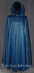 Cloak:3271, Cloak Style:Full Circle Cloak Rain Cloak, Cloak Color:Teal Blue shimmer, Fiber / Weave:100% Polyester, Cloak Clasp:Vale, Hood Lining:Unlined, Back Length:54&quot;, Neck Length:21&quot;, Seasons:Fall, Spring, Summer, Note:A bright fun rain cloak that feels<br>like fabric, moves like fabric<br>what more could you ask for?<br>Also protects from the rain and mud!<br>Can be warn with winter clothes<br>underneath for added warmth.<br>Machine washable..