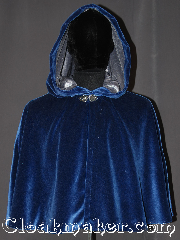 Cloak:3275, Cloak Style:Shaped Shoulder-Short, Cloak Color:Royal Blue, Fiber / Weave:Cotton Velvet, Cloak Clasp:Vale, Hood Lining:Silver silk velvet, Back Length:25&quot;, Neck Length:19&quot;, Seasons:Southern Winter, Fall, Spring, Note:A gorgeous soft royal blue<br>short shape shoulder cloak<br>is the ideal piece for<br>any prince or princess.<br>Sized for youth or lean adult<br>with a shimmer silver velvet<br>hood lining for a luxurious feel.<br>Easy care machine washable<br>Throw it on and go!<br><br>Note: slight flaw on left shoulder.