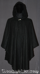 Cloak:3278, Cloak Style:Ruana Pullover Cloak, Cloak Color:Black, Fiber / Weave:Malden mills polyester fleece, Cloak Clasp:Stina Pewter, Hood Lining:Unlined, Back Length:40&quot; back<br>26&quot; overarm, Neck Length:20&quot;, Seasons:Southern Winter, Fall, Spring, Note:Kitten soft this high quality fleece<br>pullover ruana is easy care and<br>easy use. A cross<br> between a cape and a cloak,<br>a ruana is a great way to keep warm<br>while frequent, unhindered use of<br>your arms is needed with a<br>closed front with no drafts.<br>Machine washable no pilling..
