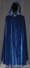 Cloak:3279, Cloak Style:Full Circle Cloak, Cloak Color:Royal Blue, Fiber / Weave:Cotton Velvet, Cloak Clasp:Triple Medallion, Hood Lining:Silver silk velvet, Back Length:53.5&quot;, Neck Length:20&quot;, Seasons:Southern Winter, Fall, Spring, Note:A gorgeous soft royal blue <br>full circle cloak is the<br>ideal piece for any king or queen.<br>Accented with a shimmer silver<br>velvet hood lining for a luxurious feel<br>and triple medallion clasp.<br>Easy care machine washable<br>Throw it on and go!.