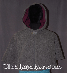 Cloak:3293, Cloak Style:Shaped Shoulder<br>Short Cloak With pockets, Cloak Color:Grey Heather, Fiber / Weave:100% Lamb Wool, Cloak Clasp:Vale, Hood Lining:Wine purple Velvet, Back Length:19&quot;, Neck Length:22&quot;, Seasons:Winter, Southern Winter, Fall, Spring, Note:A perfect short shape shoulder capelet<br>for a starter cloak or formal evening<br>during cold receptions.<br>Made of warm grey heathered lambs wool<br>and wine cotton velveteen hood lining<br>with a elegant vale pewter clasp.<br>Spot or dry clean only.