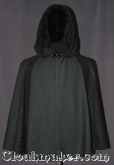 Cloak:3295, Cloak Style:3/4 Circle &quot;Pieced&quot; with Lirepipe, Cloak Color:Green two tone, Fiber / Weave:Wool blend suiting, and  Wool blend weave.<br>80% wool 20% nylon, Cloak Clasp:Vale (black enamel), Hood Lining:Unlined, with 49&quot; lirapipe, Back Length:28&quot;, Neck Length:19&quot;, Seasons:Fall, Spring, Note:Young rangers and woodland folk will adore<br>this 3/4 circle lirepipe pieced cloak.<br>Made from two different wools<br>a gabardine suiting and two side panels<br>and matching hood made of a<br>black and green wool weave.<br>A lirepipe is both useful and fashionable<br>when you wrap the elongated hood<br>around your neck in windy weather.<br>Spot or dryclean only..