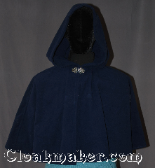 Cloak:3297, Cloak Style:Shaped Shoulder-Short, Cloak Color:Navy Blue, Fiber / Weave:Windblock Polar Fleece, Cloak Clasp:Vale, Hood Lining:Unlined, Back Length:20&quot;, Neck Length:19&quot;, Seasons:Winter, Southern Winter, Fall,Spring, Note:Made of Windbloc Fleece (a thick<br>plush material that is warm and windproof)<br> This warm and beautiful navy blue cloak <br>is perfect for cold winter months<br>the 19&quot; neck is suitable for youth to<br>young adult and will grow with your child<br>Finished with a sturdy pewter<br>Triple Medallion hook-and-eye clasp..