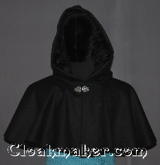 Cloak:3302, Cloak Style:Full Circle Short Cloak /Capelet, Cloak Color:Black, Fiber / Weave:100% Wool, Cloak Clasp:Vale, Hood Lining:Black Crushed Velvet, Back Length:16&quot;, Neck Length:24&quot;, Seasons:Winter, Southern Winter, Fall, Spring, Note:A perfect short capelet starter cloak<br>or formal evening during cold receptions.<br>Made of a warm black wool and<br>adorned with a elegant vale pewter clasp.<br>Dry or spot clean only..