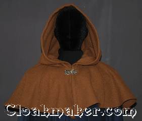 Cloak:3310, Cloak Style:Shaped Shoulder-Short, Cloak Color:Tawny brown, Fiber / Weave:100% Wool, Cloak Clasp:Vale, Hood Lining:Unlined, Back Length:14.5&quot;, Neck Length:20.5&quot;, Seasons:Southern Winter, Fall, Spring, Note:A perfect short capelet starter cloak<br>or formal evening during<br>cold receptions or child&#039;s first cloak.<br>Made of a warm tawny brown<br>100% wool and adorned with an<br>elegant vale pewter clasp.<br>Dry or spot clean only..