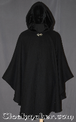 Cloak:3311, Cloak Style:Shaped Shoulder Ruana Cloak, Cloak Color:Black, Fiber / Weave:100% Wool, Cloak Clasp:Vale, Hood Lining:Black Silk Velvet, Back Length:41.5&quot;, Neck Length:23&quot;, Seasons:Winter, Southern Winter, Fall, Spring, Note:A warm and classic Shape Shoulder<br>Ruana cloak for cool fall evenings.<br>Made from 100% wool melton.<br>This cloak has a basic vale clasp<br>and black silk velvet hood lining.<br>An elegant cross between<br>a cape and a cloak, a ruana is a great way <br>to keep warm while frequent, unhindered<br>use of your arms is needed.<br>Ruanas make great driving cloaks!<br>Spot or dry clean only..