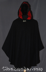 Cloak:3313, Cloak Style:Shaped Shoulder Ruana Cloak, Cloak Color:Black, Fiber / Weave:100% Wool Melton, Cloak Clasp:Vale, Hood Lining:Red moleskin, Back Length:40.5&quot;, Neck Length:20.75&quot;, Seasons:Winter, Southern Winter, Fall, Spring, Note:Made with 100% wool this<br>shaped shoulder ruana cloak<br>with a hood lined in red moleskin<br>makes a great accessory for everyday wear,<br> LARP or Renaissance Fair.<br>An elegant cross between a cape and a cloak,<br>a ruana is a great way to keep warm<br>while frequent, unhindered use of<br>your arms is needed.<br>Ruanas make great driving cloaks!<br>Spot or dry clean only..