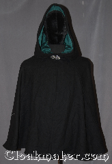 Cloak:3317, Cloak Style:Narrow shoulder multi panel, Cloak Color:Black, Fiber / Weave:100% Wool, Cloak Clasp:Vale, Hood Lining:Sea green cotton velveteen, Back Length:29&quot;, Neck Length:20.5&quot;, Seasons:Winter, Southern Winter, Fall, Spring, Note:A classic black narrow shouldered<br>multi-panel cloak is eco-conscious made<br>from slightly different black wool fabric<br>remnants wast free.<br>Ideal for cool fall evenings.<br>Made from 100% wool melton.<br>This cloak has a basic vale clasp and<br>sea green cotton velvet hood lining.<br>Designed with bulk than a full circle cloak with<br>fitted shoulders for a fitted look.<br>Spot or dry clean only..