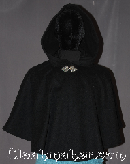 Cloak:3319, Cloak Style:Shaped Shoulder-Short, Cloak Color:Black, Fiber / Weave:100% Wool Melton, Cloak Clasp:Triple Medallion, Hood Lining:Unlined, Back Length:23.5&quot;, Neck Length:19.75&quot;, Seasons:Winter, Southern Winter, Fall, Spring, Note:This youth short capelet is a perfect child&#039;s<br>first cloak that will grow<br>with your child for years to come.<br>Short enough for play and made of a rugged, warm<br>black 100% wool and adorned with<br>an elegant pewter triple medallion clasp.<br>Dry or spot clean only..