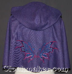 Cloak:3343, Cloak Style:Shaped Shoulder-Short, Cloak Color:Purple heathered<br> Embroidered butterfly, Fiber / Weave:Wool Blend, Cloak Clasp:Antiquity, Hood Lining:Unlined, Back Length:17.5&quot;, Neck Length:20&quot;, Seasons:Fall, Spring, Note:&quot;Butterflies are self propelled flowers.&quot;<br>? Robert A. Heinlein<br>For a dazzling addition to your wardrobe,<br>try this eye catching  embroidered<br>shape shoulder capelet. <br>A fun and dramatic wool blend<br>purple heathered cloak is decorated<br>with pink, purple and blue<br>butterfly wings and an antique<br>silver-tone antiquity hook-and-eye clasp.<br> For a little magic in your day.<br>Dry Clean Only..