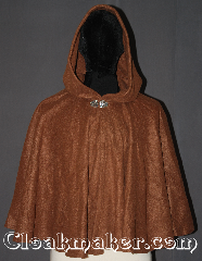 Cloak:3363, Cloak Style:Full Circle Cloak Short<br>3 pieces, Cloak Color:Caramel Brown, Fiber / Weave:Fleece, Cloak Clasp:Vale, Hood Lining:Unlined, Back Length:24&quot;, Neck Length:21&quot;, Seasons:Fall, Spring, Note:A cloak that will last from childhood to<br>adult this lightweight economy fleece<br> provides a warmth with very little weight.<br>This caramel full circle three piece cloak<br>is suitable for indoor wear late spring,<br>early fall, cool summer evenings or<br>just snuggling on the couch.<br>Easy care machine washable..