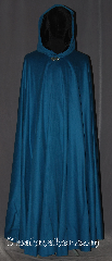 Cloak:3364, Cloak Style:Full Circle Cloak, Cloak Color:Teal Blue, Fiber / Weave:25%  Cashmere, Cloak Clasp:Vale, Hood Lining:Black Silk Velvet, Back Length:55&quot;, Neck Length:23.5&quot;, Seasons:Fall, Spring, Southern Winter, Winter, Note:A gorgeous soft teal blue<br>full circle cloak is the ideal piece<br>for any king or queen.<br>Accented with a black silk velvet<br>hood lining for a<br>luxurious feel and vale clasp.<br>Dry clean only.