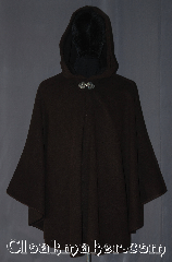 Cloak:3373, Cloak Style:Shaped Shoulder Ruana Cloak, Cloak Color:Heathered Chocolate Brown, Fiber / Weave:80% Wool / 20% Nylon, Cloak Clasp:Triple Medallion, Hood Lining:Unlined dark brown interior double sided fabric, Back Length:33&quot; back<br>27&quot; side, Neck Length:21&quot;, Seasons:Southern Winter, Fall, Spring, Note:This heathered chocolate brown<br>shape shoulder ruana is made with a<br>lovely dark interior for a classic look.<br>This cloak is made of a Wool blend with a<br>silvertone triple medallion hook and eye clasp<br>A cross between a cape and a cloak,<br>a ruana is a great way to keep warm<br>while frequent, unhindered use<br>of your arms is needed.<br>Ruanas make great driving cloaks!<br>Dry clean only..