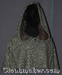 Cloak:3379, Cloak Style:Shaped Shoulder-Short (youth), Cloak Color:Green, white, red, brown black Boucle, Fiber / Weave:80% Wool / 20% Nylon, Cloak Clasp:Vale, Hood Lining:Unlined, Back Length:14.5&quot;, Neck Length:19.75&quot;, Seasons:Fall, Spring, Note:Become invisible in the dense forests<br>of Araluen with this one of a kind<br>shape shoulder capelet Green, white,<br>red, brown black boucle cloak.<br>The pride of any youth Ranger&#039;s Apprentice.<br>Adorned with a silver tone Vale clasp.<br>Dry clean only..