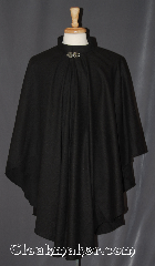 Cloak:3392, Cloak Style:Ruana Cloak<br>Casco Bay inspired, Cloak Color:Black, Fiber / Weave:Wool Blend Suiting, Cloak Clasp:Vale, Hood Lining:N/A, Back Length:40&quot;<br>23.5&quot; overarm, Neck Length:21&quot;, Seasons:Fall, Spring, Southern Winter, Note:Warm enough for new england leaf peeping.<br>A cross between a cape and a cloak,<br>a ruana is a great way to keep warm<br>while frequent, unhindered use of<br>your arms is needed.<br>This black collared ruana cloak<br>is not as soft as our other cloaks<br>with a slight classic wool feel that<br>may soften with wear.<br>Adorned with a vale hook and eye clasp<br> Ruanas make great driving cloaks!<br>Machine washable.
