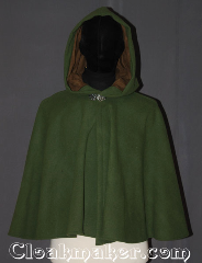 Cloak:3448, Cloak Style:Shaped Shoulder-Short, Cloak Color:Green, Fiber / Weave:80% Wool / 20% Nylon cashmere blend, Cloak Clasp:Vale, Hood Lining:Brown Faux Suede, Back Length:24&quot;, Neck Length:20&quot;, Seasons:Southern Winter, Fall, Spring, Note:With a lavish feel all over, this soft<br>sage green short shape shoulder cloak<br>will get you complements<br>everywhere you go.<br>The cloak is made of a wool nylon<br>cashmere blend accented with<br>a soft brown lined faux suede hood,<br>and gold tone triple medallion<br>hook and eye clasp.<br> Perfect for a child to grow with<br> or a light shrug for<br>a night on the town<br>Spot or dry clean only..