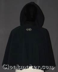 Cloak:3450, Cloak Style:Full Circle Cloak Short, Cloak Color:Navy Blue, Fiber / Weave:WindPro Fleece, Cloak Clasp:Triple Medallion, Hood Lining:Unlined faux shearling<br>interior double sided fabric, Back Length:21&quot;, Neck Length:21&quot;, Seasons:Winter, Southern Winter, Fall, Spring, Note:This navy blue windpro ruana cloak<br>will keep you warm and dry<br>on chilly nights.<br>Perfect for a child to grow with<br>or a warm shrug<br>for a night on the town.<br>This soft and cuddly cloak has an<br>interior faux shearling texture<br>for extra comfort and a water<br> resistant outer layer to keep<br> you dry during light rain/snow.<br>The silver-tone triple medallion clasp<br>is the final touch on this<br>functional and elegant cloak.<br>Machine washable<br>DO NOT DRY CLEAN..